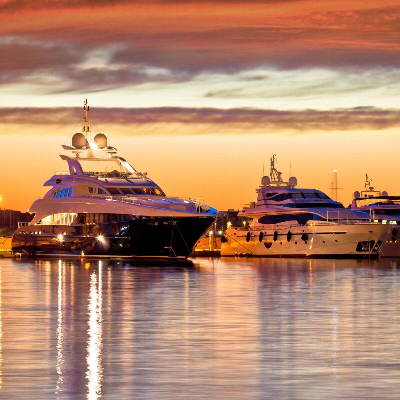 Luxury yachts docked at sunset